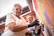 08/09/2015 - Lisbon, Portugal: Isaura Santos Costa, 90, and Olinda Rodrigues, 66, paint a wall during the Lata 65 workshop. Lata 65 was project created by Lara Seixo Rodrigues and is a creative workshop teaching street art to senior citizens. (Eduardo Leal)