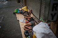 Many families sleep on the streets of Malate, often suffering not only from poverty but substance abuse problems.  Malate, Manilia, Philippines.