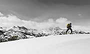 Backcountry skier under Banner and Ritter Peaks, Ansel Adams Wilderness, Sierra Nevada Mountains, California