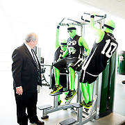 Orem Mayor Richard Brunst, left watches members of UVU's Green Man Group try out the excersize equipment prior to the Ribbon Cutting for the new UVU Student Life and Wellness Center on the campus of Utah Valley University in Orem, Utah Thursday April 17, 2014. (Nathaniel Ray Edwards, UVU Marketing)