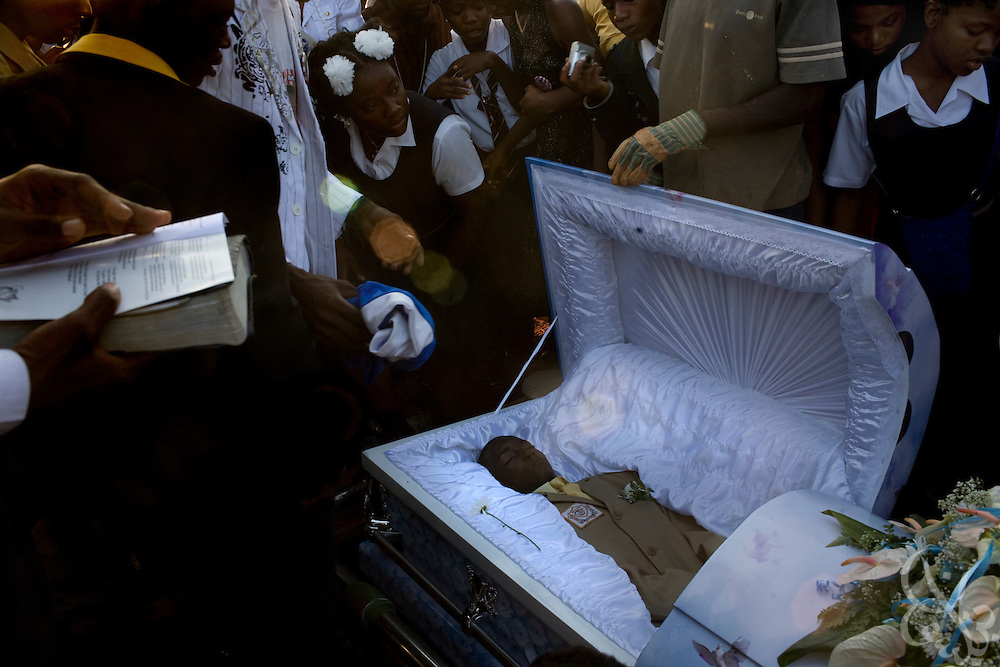 The body of Shevon Johnson (age 16) is laid to rest by school mates and family members at the Dovecott cemetery in Spanish Town December 14, 2008. Johnson was stabbed to death by a classmate after a disagreement over a cell phone at the Dunoon Technical High School in Kingston, Jamaica November 17, 2008. Violence in Jamaican schools has increased along with the overall rates of violence in murder in Jamaica.