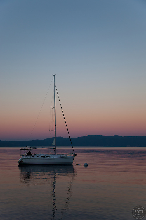 """Sailboat and Sunset on Lake Tahoe 1"" - This serene sunset was photographed from the West shore of Lake Tahoe, California."
