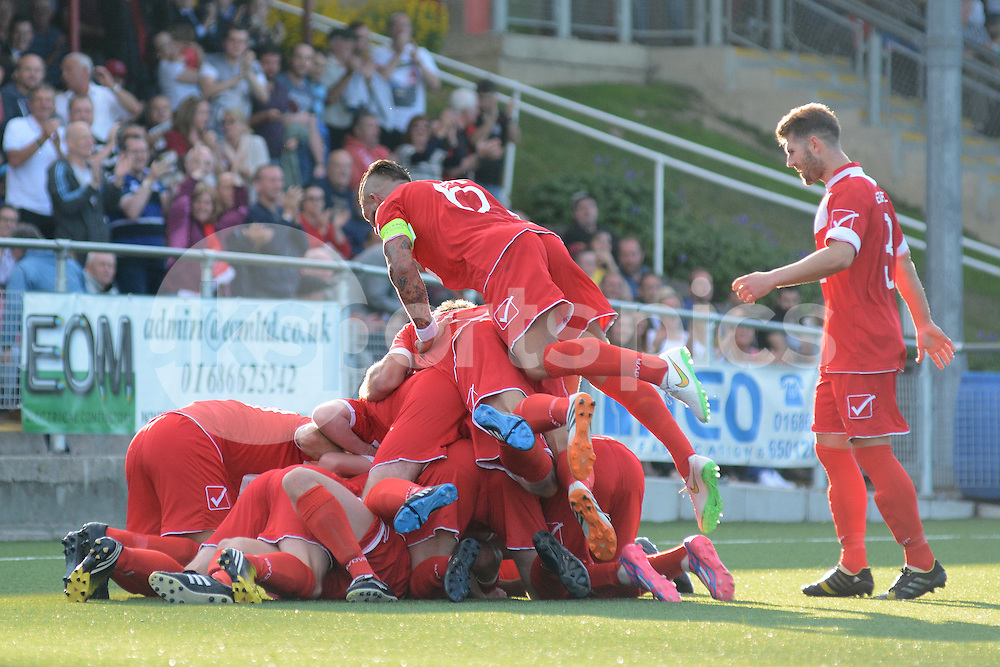 Newtown's players celebrate Luke Boundford's opening goal during the Europa League Qualifying match between Newtown AFC and Valletta FC at Paveways Latham Park Stadium, Newtown, Powys, Wales on 2 July 2015. Photo by Garry Griffiths.