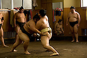 Morning practice and breackfast in SUMO STABLE TAKASAGO which is the stable of the East Yokozuna Asashoryu, one of the top sumo wrrestlers in Japan. He was not in the stable during the shooting because he often trains by himself especially afyer he started having problems with the sumo authorities.