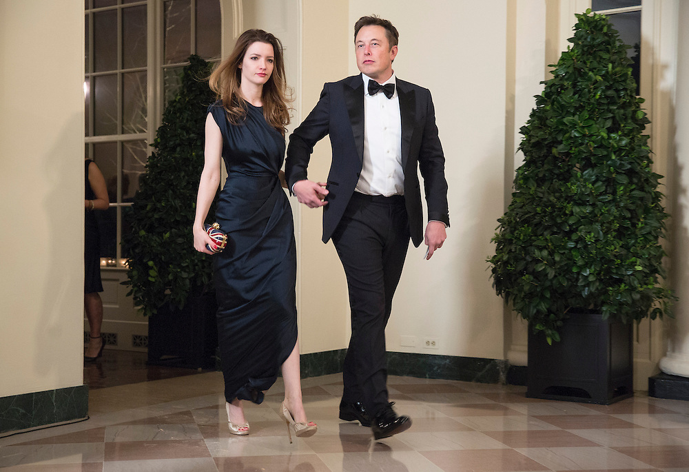 Entrepreneur Elon Musk and his wife Talulah Musk arrive for the State Dinner being held for French President Francois Hollande at the White House in Washington on February 11, 2014.      REUTERS/Joshua Roberts    (UNITED STATES)