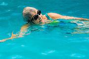 Senior woman swimming in a swimming pool