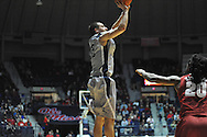 """Mississippi's Marshall Henderson (22) vs. Alabama at the C.M. """"Tad"""" Smith Coliseum in Oxford, Miss. on Wednesday, February 26, 2014. (AP Photo/Oxford Eagle, Bruce Newman)"""