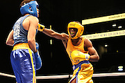 April 1, 2015 - New York, NY. Richardson Hitchins (gold) reaches for Michael Hughes (blue). 04/01/2015 Photograph by Maya Dangerfield/NYCity Photo Wire