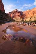 Nankoweap Mesa reflects in the waters of a small creek. Grand Canyon National Park in Arizona.
