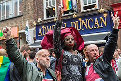 Old Compton Street, Soho, London, June 13th 2016. Thousands of LGBT people and their friends converge on Old Compton Street in London's Soho to remember the fifty lives lost in the attack on gay bar Pulse in Orlando, Florida. PICTURED: Solidarity outside the Admiral Duncan pub, a popular LGBT venue which was itself a victim of a homophobic attack in 1999 when a neo-Nazi's nail bomb killed three and injured 70.
