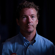 Sen. Rand Paul listens as his father and Republican presidential hopeful Rep. Ron Paul takes part in the Iowa Straw Poll Saturday, August 13, 2011, in Ames, Iowa (IA)...Photo by Khue Bui.
