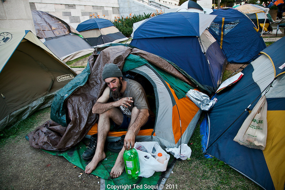 Dex, a homelessman sitting in his tent..Occupy L.A. last day before getting evicted. Mayor Antonio Villaraigosa has set up a deadline of 12:01am Monday morning for the campers to be gone from the city hall lawn.