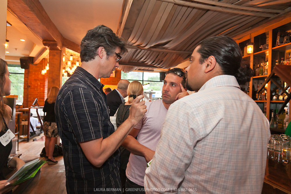 Paul DeCampo talks with ... and Chef Luis Valenzuela at the  Mega-quarry information session at Marben, June 28, 2011.