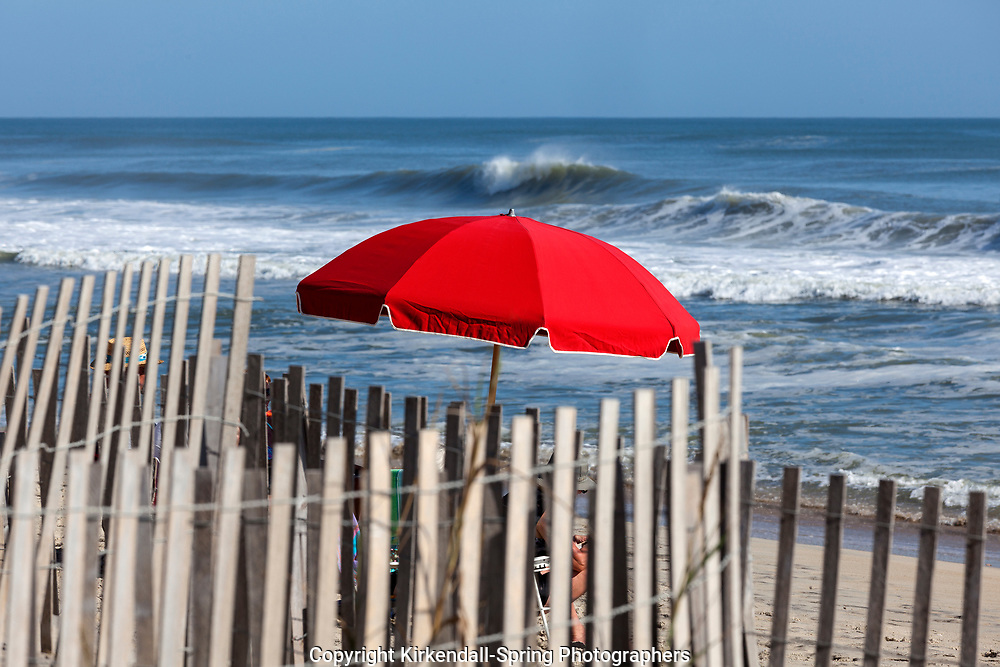 NC00747-00...NORTH CAROLINA - Red umbrella on the beach at Rodanthe in the Outer Banks, Cape Hatteras National Seashore.