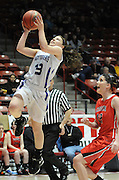 gbs030912aa/SPORTS/Greg Sorber --  Elida's Hunter Haley, left, scores on a fast break in front of Corona's Allysanne Huey, 13, B Girls State Championship game in the Pit on Friday, March 9, 2012. Elida won 59-41.
