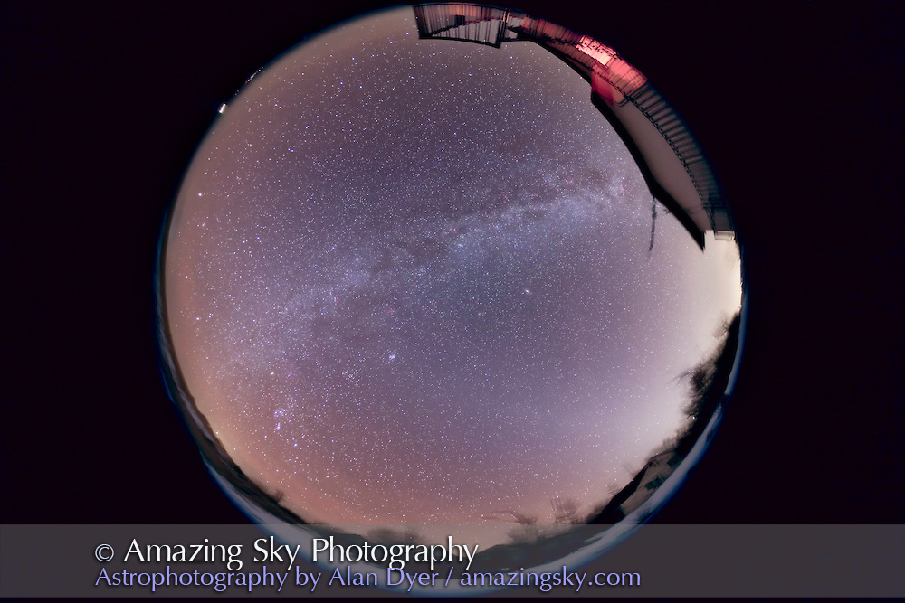 Fish-eye all-sky of the northern winter sky, taken about 8 pm, January 16, 2010, from home. Taken with Canon 5D MkII camera at ISO 800, with Sigma 8mm fish-eye lens at f/4 for stack of 3 x 4 minute exposures, combined with Median Combine to retain foreground detail and eliminate satellites and aircraft. Zodiacal Light is at right, in evening sky. Yellow glow above it behind house is urban glow from Strathmore and Calgary. Autumn and winter Milky Way arcs across frame. Mars is just rising at 9:30 position at left. Jupiter going down in the trees at 4:00 position at right. Sirius just coming up at 8:00 position at lower left.