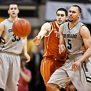 SHOT 2/26/11 5:01:57 PM - Colorado's Marcus Relphorde (#5) is guarded by Texas' Dogus Balbay (#4) during their regular season Big 12 basketball game at the Coors Events Center in Boulder, Co. Colorado upset the fifth ranked Texas 91-89. (Photo by Marc Piscotty / © 2011)