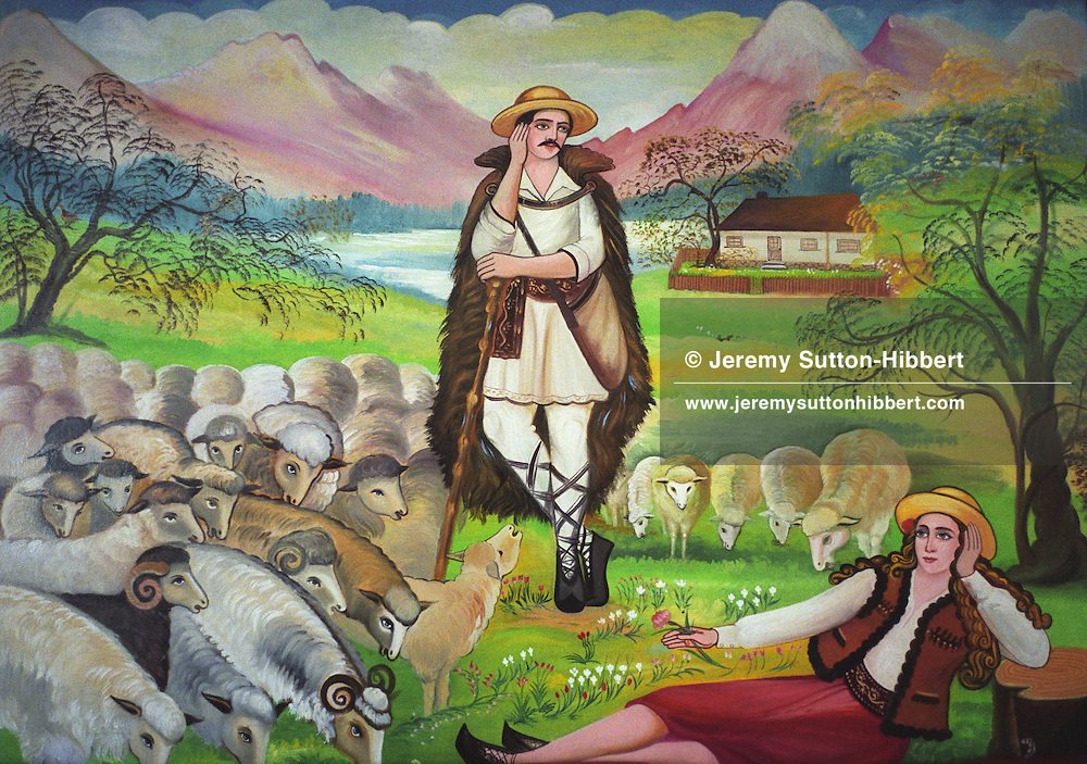 A Transylvanian rural scene showing a shepherd with his flock, and a woman, painted on the wall of a Roma home, in the new part of the Sintesti Roma camp. rural scenes are one of the more popular scenes to be found painted on the walls of the homes..