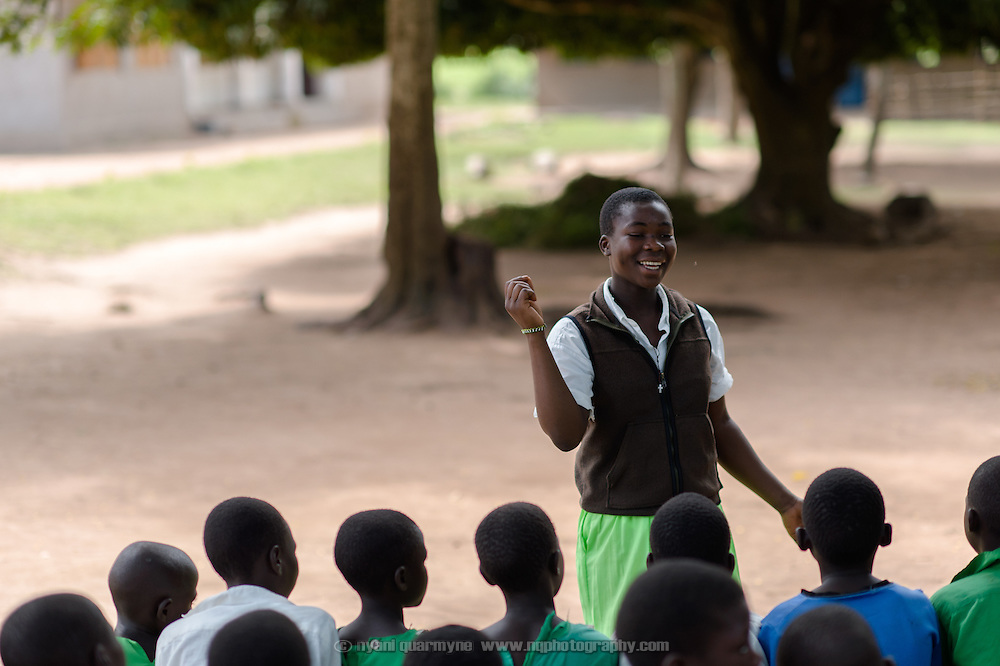Peninah Mamayi, the Health Prefect at her school, giving an animated and entertaining talk about a range of hygiene and health issues, including menstrual hygiene, at Achilet Primary School near Tororo in Eastern Uganda on 1 August 2014. Education about menstruation is provided to both boys and girls to destigmatise it, and to improve the general level of knowledge about it in the community.