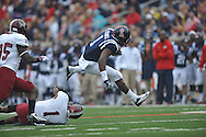 Mississippi's Laquon Treadwell (1) eludes Troy safety Camren Hudson (1) to score at Vaught-Hemingway Stadium in Oxford, Miss. on Saturday, November 16, 2013. Ole Miss won 51-21.