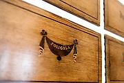 Palermo 2010 - Casa editrice Enzo Sellerio, sala d'aspetto e show room. Particolare degli arredi: cassetti da farmacia.