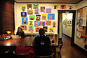 A gallery of sock monkey drawings fill the wall of Foxy Loxy Print Gallery & Cafe in historic downtown Savannah, Ga. (Photo by Stephen Morton)