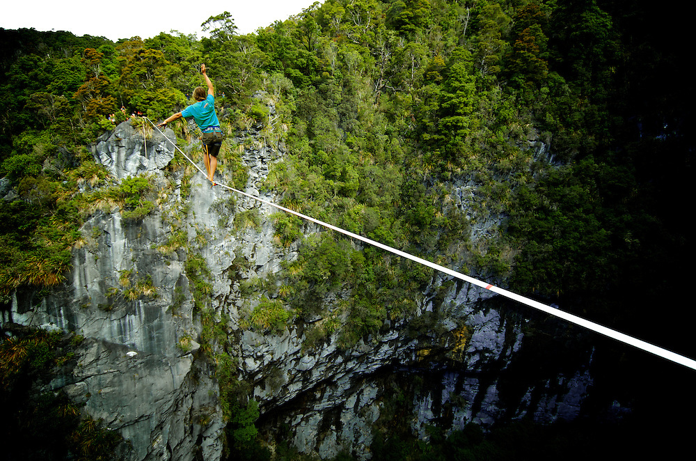 Florian Herla on the walk back of his first ascent of the Harwoods hole highline. New Zealand.