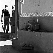 IPLM0021 , South Africa, Venda, June 2001. Battery powered radio in a traditional Venda village.