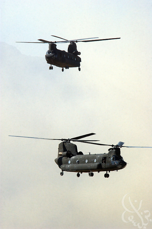 U.S. Army CH-64 Chinook helicopters land at Bagram airbase in central Afghanistan July 16, 2002. The Chinook is a dual rotor heavy lifting and troop transport specialist that is used extensively in Afghanistan by US and coalition forces.