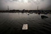 A keyboard lies in a polluted lagoon at Agbogbloshie dump, in Accra, Ghana. E-waste is dumped in West Africa from the US, Europe and Japan and many of the toxic elements this waste contains pose a threat to human life, water bodies and the environment.