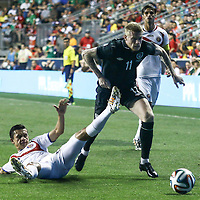 Republic of Ireland Midfielders James McClean (11) dribbles the ball up the field as Costa Rica Midfielders Jose Miguel Cubero (22) defends in the second half of the inaugural freedom cup between Ireland and Costa Rica Friday. June. 6, 2014 at PPL Park in Chester PA.