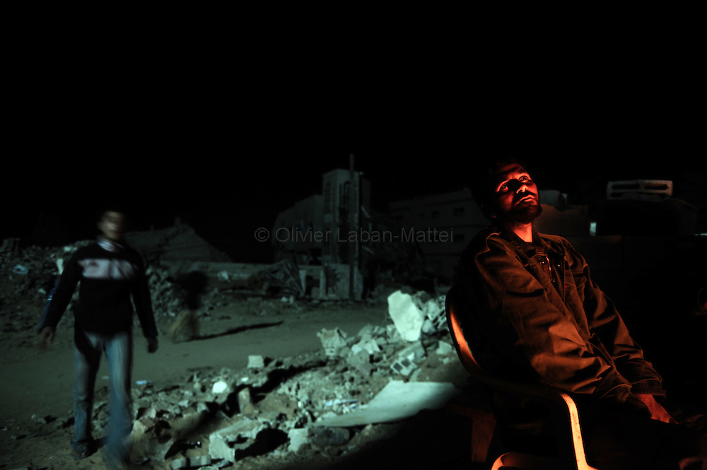 A Palestinian man sits next to the rubble of his destroyed house in Jabalia's Ezbet Abed Rabbo district in the northern Gaza Strip late on January 30, 2009. A rocket fired by Palestinian militants from the Gaza Strip exploded in southern Israel on January 31, but there were no casualties or damage reported, the Israeli army said. It is the third rocket attack since ceasefires on January 18 brought an end to Israel's three-week onslaught against Gaza which left more than 1,330 Palestinians dead.