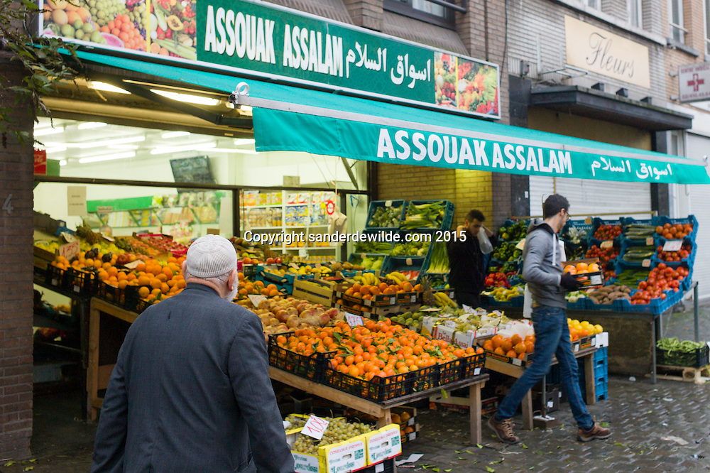 Belgium, Brussels, Sint Jans Molenbeek. 12 December 2015.  Molenbeek, the community of Brussels where terrorists of the Paris attacks lived. A typical shop selling vegetables and more, with its name in arab signs. an older man passes by why young guys arrange the fruit. (Sander de Wilde for National Post)(For story by Matthew Fischer, foreign correspondent)
