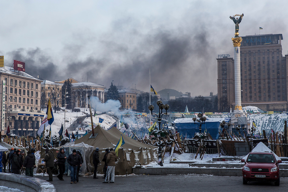 KIEV, UKRAINE - JANUARY 25: Smoke rises from clashes between anti-government protesters and police on Hrushevskoho Street near Dynamo stadium, as seen from Independence Square, on January 25, 2014 in Kiev, Ukraine. After two months of primarily peaceful anti-government protests in the city center, new laws meant to end the protest movement have sparked violent clashes in recent days. (Photo by Brendan Hoffman/Getty Images) *** Local Caption ***