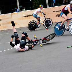 London, UK - 24 August 2012: a player falls off her bike during the Hell's Belles Vol 2, Ladies Bike Polo Tournament in Bethnal Green Gardens.