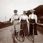 3 ladies on bikes, circa 1900
