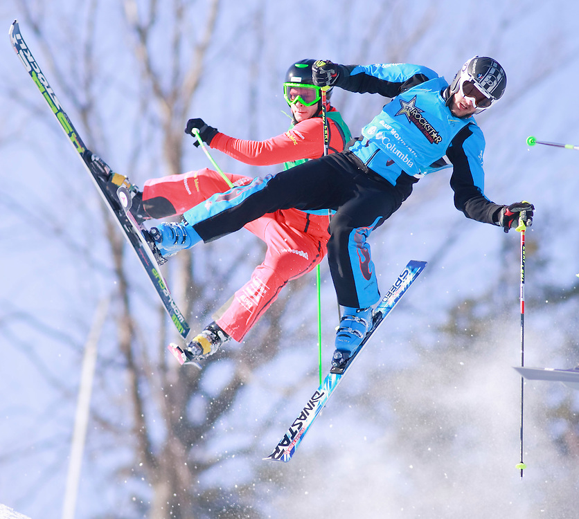 -20110211- Collingwood, Ontario,Canada -- Yann Dumax Baudron, of France leads Patrick Gasser of Switzerland during the quarter finals of the Rockstar Ski Cross Grand Prix race at Blue Mountain in Collingwood, Ontario, February 11, 2011.<br /> AFP PHOTO/Geoff Robins