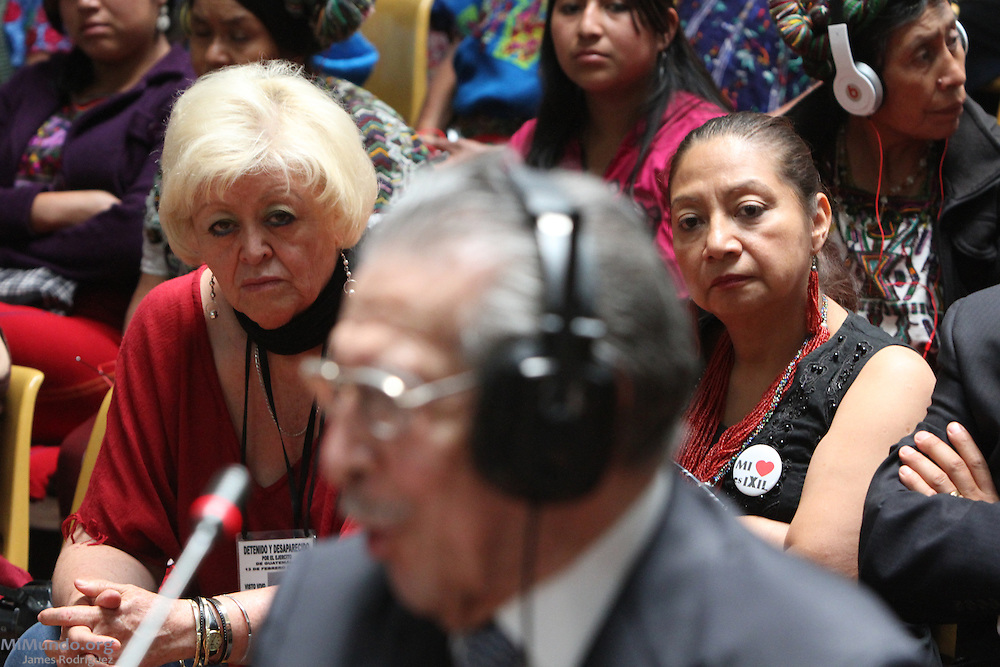 Efrain Rios Montt, former de facto head of state accused of Genocide against the Ixil Mayan people, is watched by human rights activists Marylena Bustamante (left) and Iduvina Hernandez. Guatemala City, Guatemala. May 9, 2013.