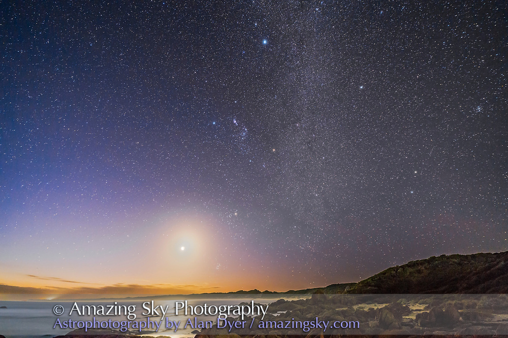 The waxing crescent Moon and Orion setting into the west and evening twilight from Cape Conran, on the Gippsland Cost of Victoria, Australia, March 31, 2017. Sirius is at top and the stars of Gemini at right. Taurus is below Orion with the Pleiades below the Moon just above the horizon, <br /> <br /> This is a stack of 4 x 30-second exposures for the ground to smooth noise and one 30-second exposure for the sky, with a short 2-second exposure of the Moon blended in to prevent to Moon from overexposing too much. All with the 14mm Rokinon lens at f/2.5 and Canon 6D at ISO 3200.