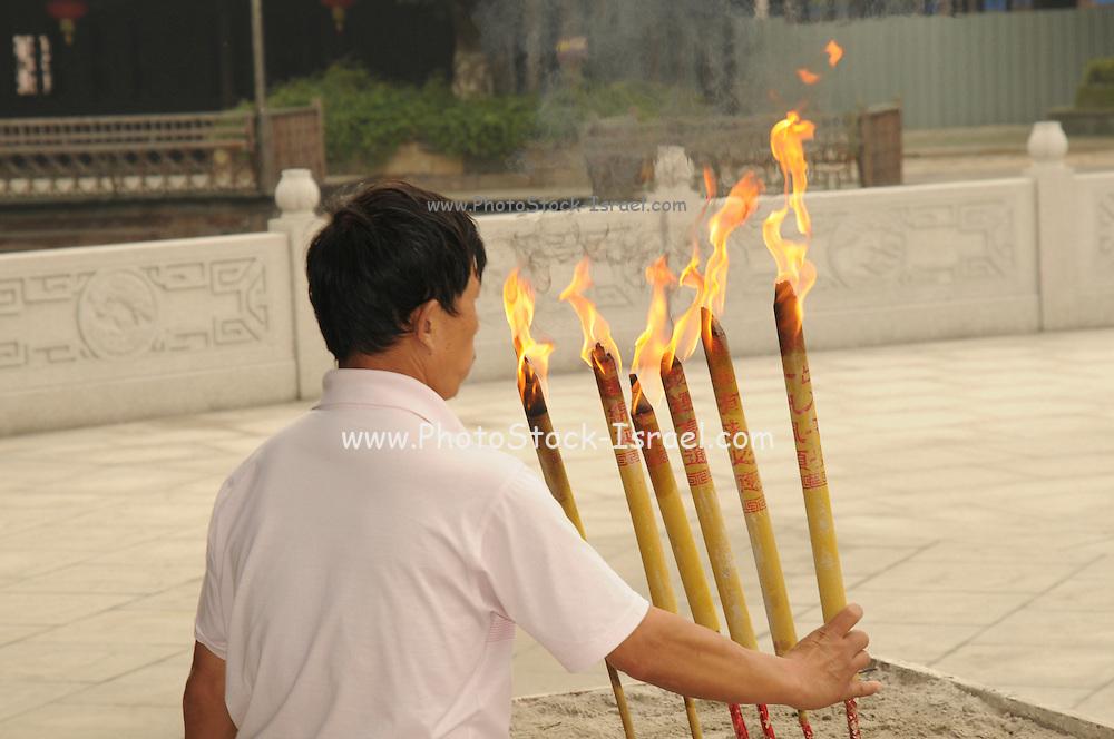 China, Zhejiang Province, Wuzhen Burning essence in a temple