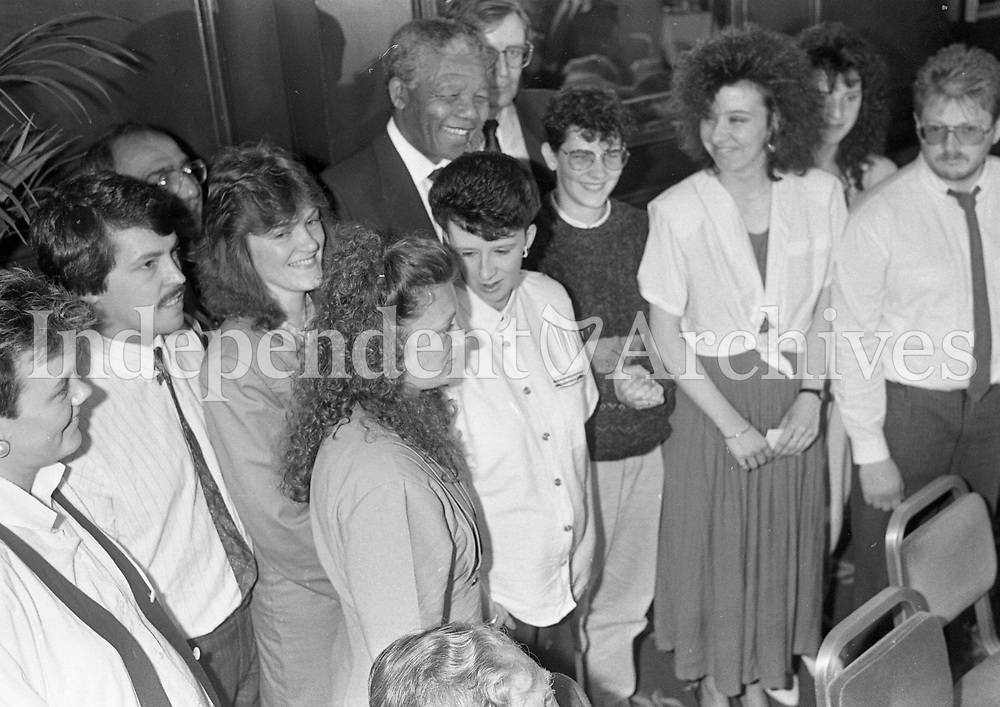 Nelson Mandela is greeted by childern on his arrival at the Berkley Court Hotel, 02/07/1990 (Part of the Independent Newspapers Ireland/NLI Collection).