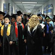 John Dickinson High School graduates prepare for the start of the 55th commencement exercises Saturday, June 06, 2015, at The Bob Carpenter Sports Convocation Center in Newark, Delaware.