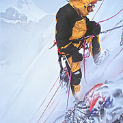 American mountaineer Jay Smith belaying another climber while enduring a deluge of spindrit avalanches during an attempt to climb the north face of Thelay Sagar, in the Garwal Himal of India.