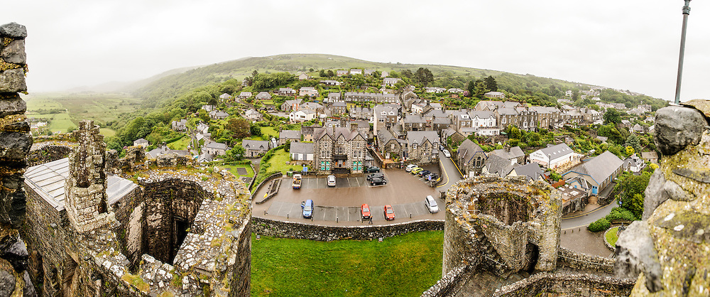 Panorama from the top of a tower at Harlech Castle in Harlech, Gwynedd, on the northwest coast of Wales next to the Irish Sea. The castle was built by Edward I in the closing decades of the 13th century as one of several castles designed to consolidate his conquest of Wales.
