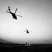 US supplied helicopters take off from a forward operating base in Tame, Aruaca on a search and destroy mission against insurgent forces in the area.