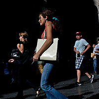 People walk along a central plaza in downtown Buenos Aires, Argentina.