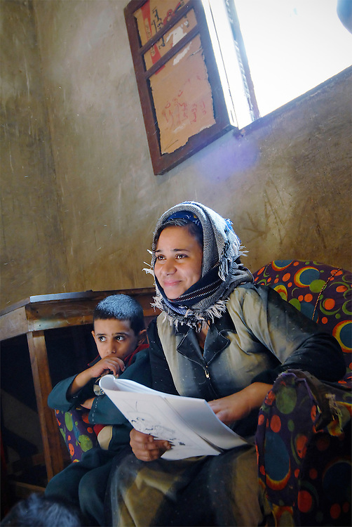 EGYPT, DEIR AL BARSHA: Deir al Barsha is a tiny, very poor village in middle Egypt. This women are beneficaries of micro credits. In order to be able to run their enterprises they attend a literacy class, in which they also learn the basics of math.