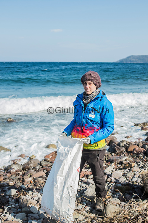 Alki, a young greek volounteer from Athens, taking care of the beach cleaning program by the Swedish NGO Lighthouse Relief. Here working cleaning the northern beaches of Lesbos from what is left  from the refugees' arrivals