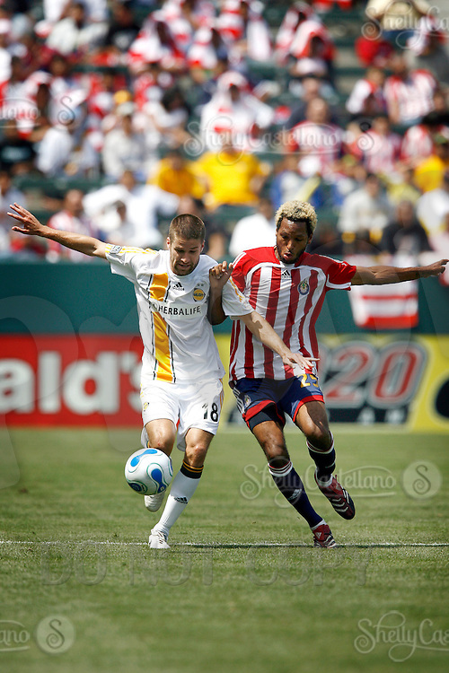 20 May 2007: Galaxy #18 Kyle Martino fights over the soccer ball with Chivas player #25 Lawson Vaughn  during a 1-1 tie for MLS Chivas USA vs. Los Angeles Galaxy pro soccer teams at the Home Depot Center in Carson, CA.