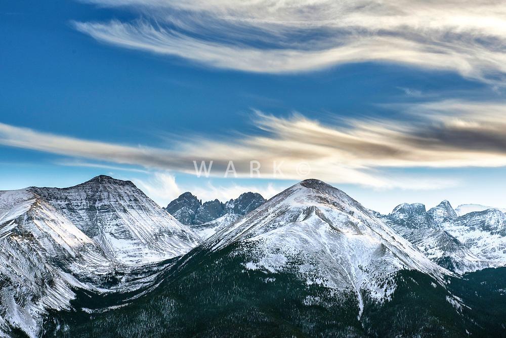 Snow capped mountain peaks with wispy clouds. Sangre de Cristo range, Colorado. Feb 2014.